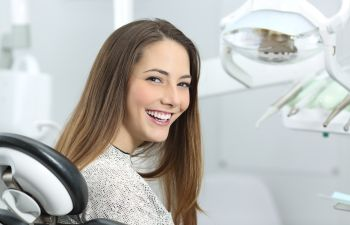 Young smiling woman in a dental chair