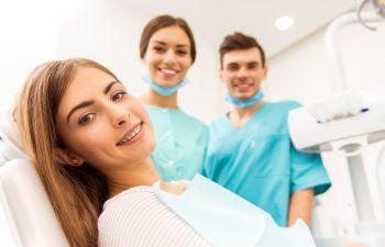 A satisfied woman in a dental chair after dental procedure in Marietta, GA.